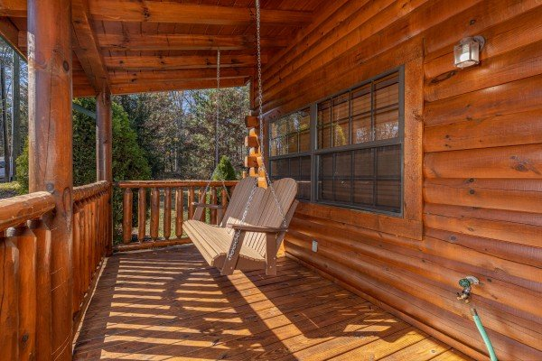 Swing on the porch at 3 Crazy Cubs, a 5 bedroom cabin rental located in Pigeon Forge