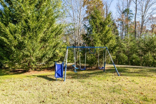Swingset in the yard at 3 Crazy Cubs, a 5 bedroom cabin rental located in Pigeon Forge