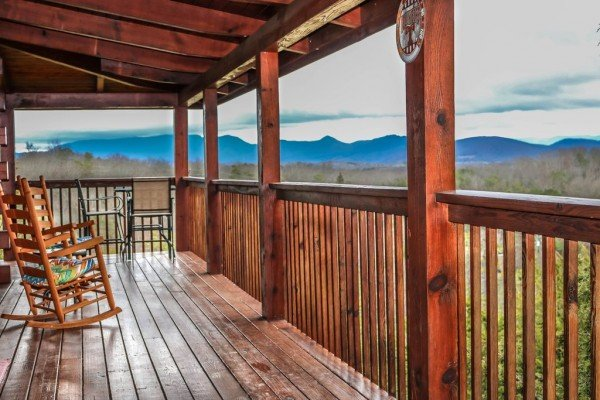 Mountain views from the covered deck at Eagle's Nest, a 2-bedroom cabin rental located in Sevierville