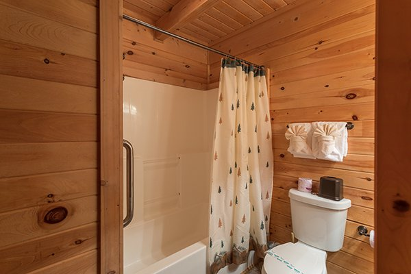 Bathroom with a tub and shower at Eagle's Nest, a 2-bedroom cabin rental located in Sevierville