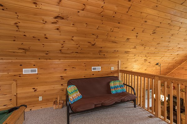 Futon in the game loft at Eagle's Nest, a 2-bedroom cabin rental located in Sevierville