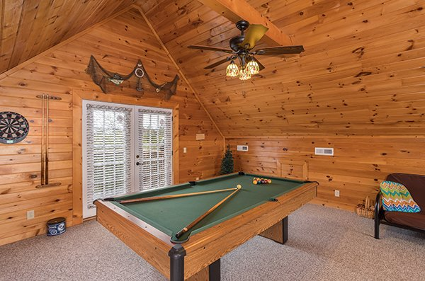 Pool table in the loft near deck access at Eagle's Nest, a 2-bedroom cabin rental located in Sevierville