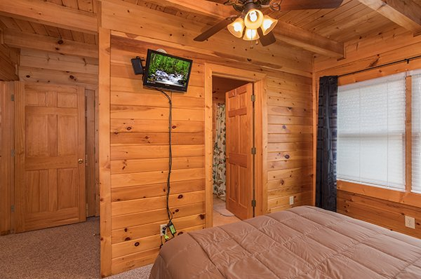 Wall-mounted television in a bedroom at Eagle's Nest, a 2-bedroom cabin rental located in Sevierville
