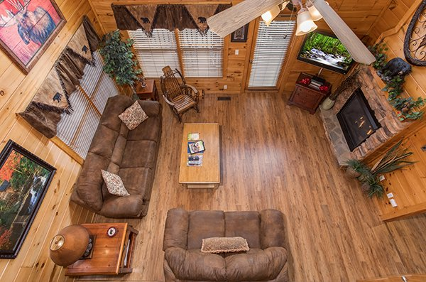 Overhead view of the living room at 5 Star Celebration, a 1 bedroom cabin rental located in Pigeon Forge
