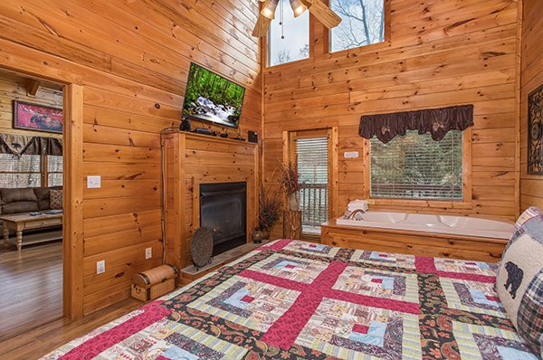 Bedroom with fireplace and jacuzzi at 5 Star Celebration, a 1 bedroom cabin rental located in Pigeon Forge