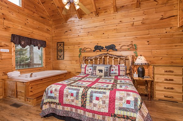 Bedroom with a jacuzzi tub at 5 Star Celebration, a 1 bedroom cabin rental located in Pigeon Forge