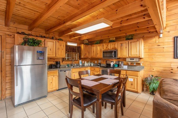 Kitchen with dining room at 5 Star Celebration, a 1 bedroom cabin rental located in Pigeon Forge
