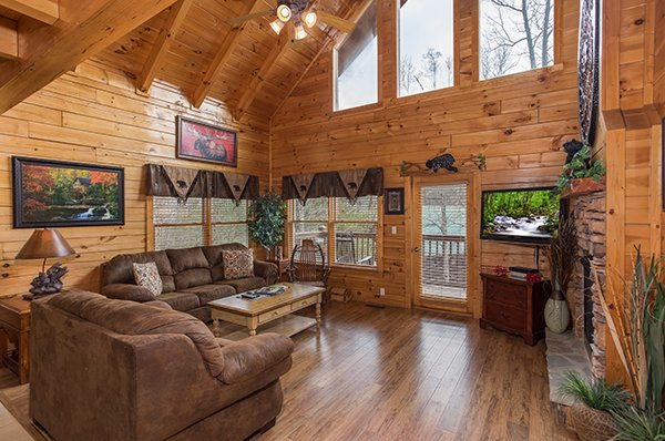 Living room with couch and loveseat at 5 Star Celebration, a 1 bedroom cabin rental located in Pigeon Forge