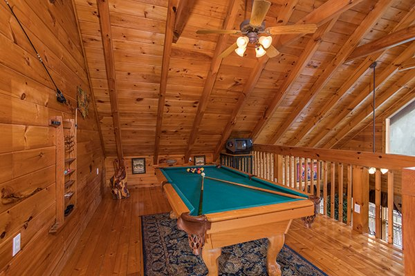 Pool table in the loft at 5 Star Celebration, a 1 bedroom cabin rental located in Pigeon Forge