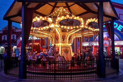 the carousel at night at the island near 5 star celebration a 1 bedroom cabin rental located in pigeon forge