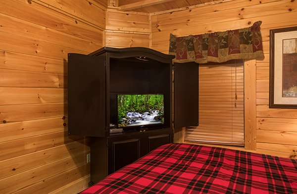 amoire with television at 5 little cubs a 2 bedroom cabin rental located in pigeon forge