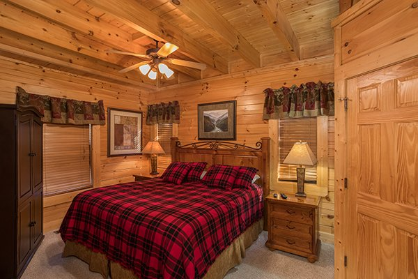 Bedroom with armoire at 5 Little Cubs, a 2 bedroom cabin rental located in Pigeon Forge