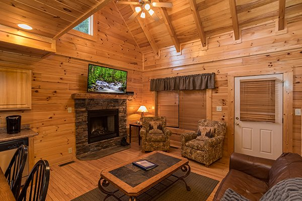 great room with fireplace at 5 little cubs a 2 bedroom cabin rental located in pigeon forge