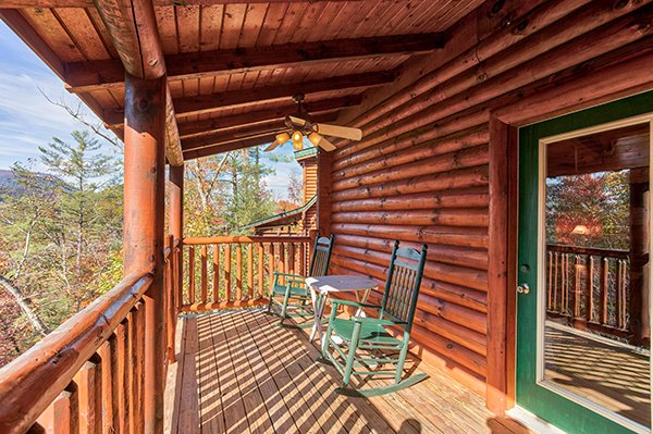 rocking chairs on a covered deck at 5 little cubs a 2 bedroom cabin rental located in pigeon forge
