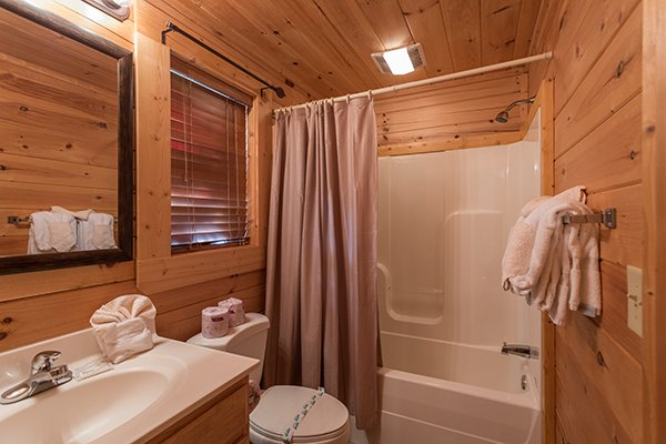 Bathroom with tub and shower at 5 Little Cubs, a 2 bedroom cabin rental located in Pigeon Forge