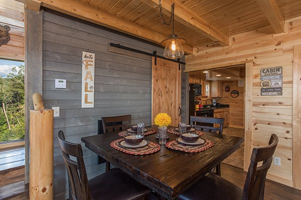 Dining table for four at The Sugar Shack, a 2 bedroom cabin rental located in Pigeon Forge