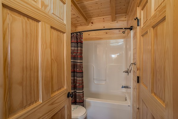 Bathroom with tub and shower at The Sugar Shack, a 2 bedroom cabin rental located in Pigeon Forge