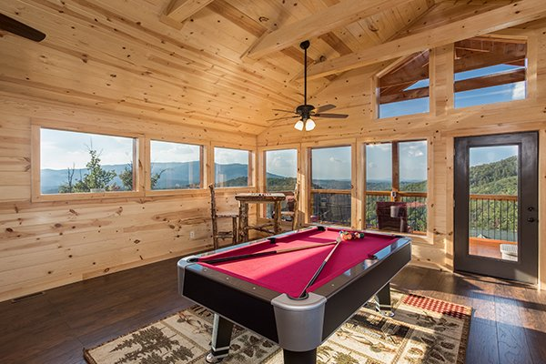 Pool table in the loft at The Sugar Shack, a 2 bedroom cabin rental located in Pigeon Forge