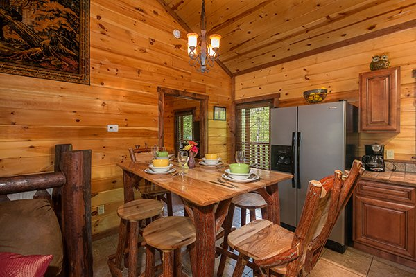 Dining space for six in the kitchen at Tennessee Treasure, a 3 bedroom cabin rental located in Pigeon Forge