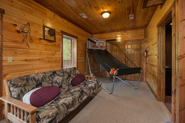 Futon and basketball game at Tennessee Treasure, a 3 bedroom rental cabin in Pigeon Forge