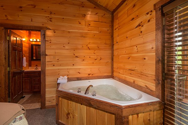 Jacuzzi in a corner of a bedroom at Tennessee Treasure, a 3 bedroom cabin rental located in Pigeon Forge