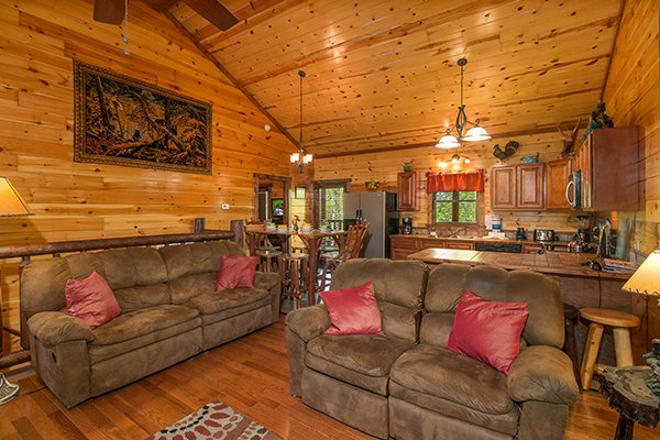 Sofa and loveseat in the living room at Tennessee Treasure, a 3 bedroom cabin rental located in Pigeon Forge