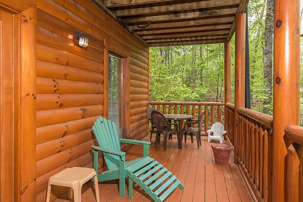 Lounge chair and dining space for four at Tennessee Treasure, a 3 bedroom rental cabin in Pigeon Forge
