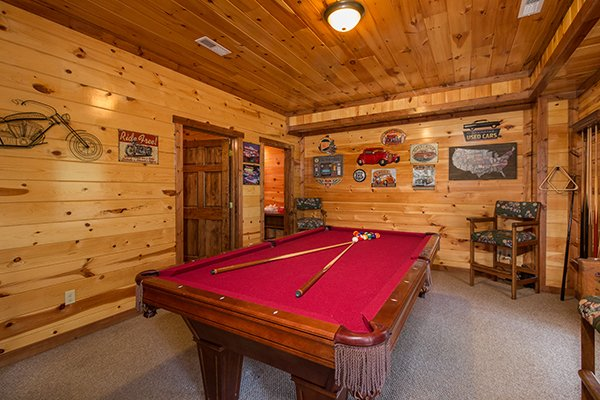 Pool table in the game room at Tennessee Treasure, a 3 bedroom cabin rental located in Pigeon Forge