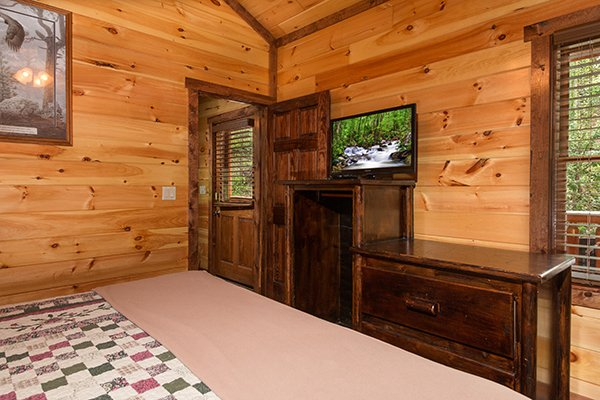Dresser and TV in a bedroom at Tennessee Treasure, a 3 bedroom cabin rental located in Pigeon Forge
