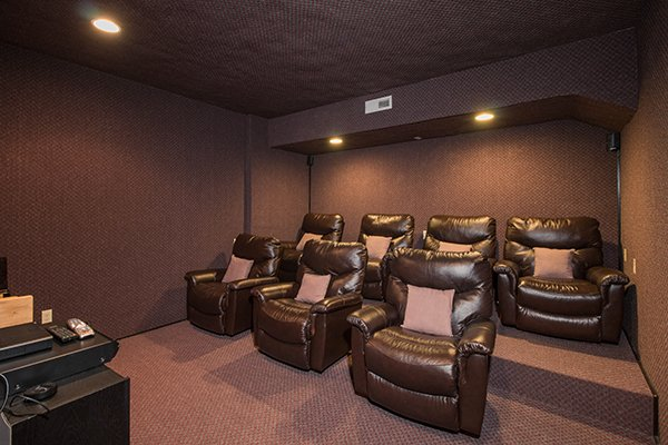 Theater room with stadium seating and recliners at Tennessee Treasure, a 3 bedroom cabin rental located in Pigeon Forge