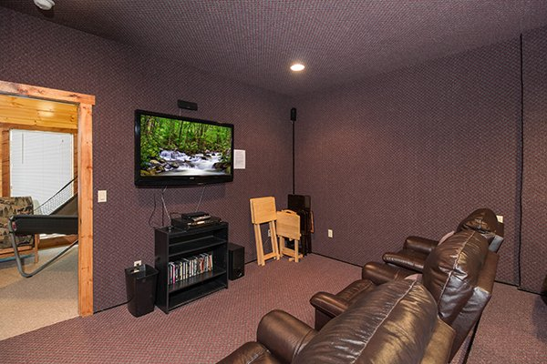 Theater room with large recliners at Tennessee Treasure, a 3 bedroom cabin rental located in Pigeon Forge