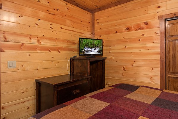 Dressers and TV in the third bedroom at Tennessee Treasure, a 3 bedroom rental cabin in Pigeon Forge