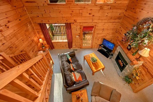 Looking down into the living room at Secluded Pleasure, a 1 bedroom cabin rental located in Pigeon Forge