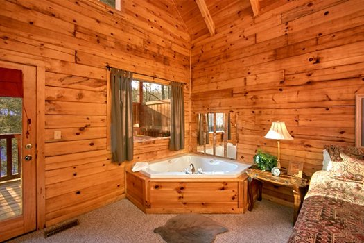 Jacuzzi in a corner at Secluded Pleasure, a 1 bedroom cabin rental located in Pigeon Forge