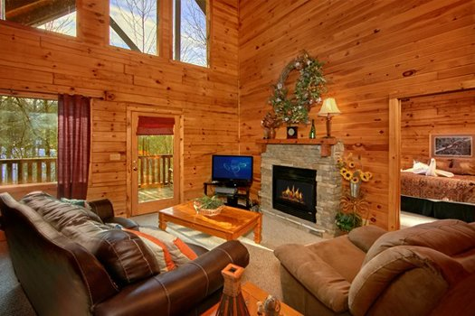 Living room with fireplace and TV at Secluded Pleasure, a 1 bedroom cabin rental located in Pigeon Forge