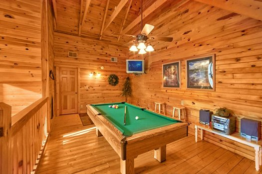 Pool table and CD player in the game loft at Secluded Pleasure, a 1 bedroom cabin rental located in Pigeon Forge