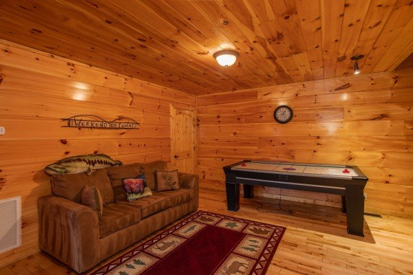 Air hockey table and a sleeper sofa at Black Bear Hide-out, a 3-bedroom cabin rental located in Pigeon Forge