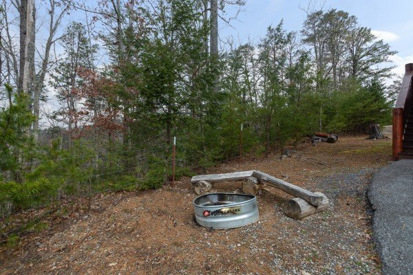 Fire pit off the deck at Black Bear Hide-out, a 3-bedroom cabin rental located in Pigeon Forge