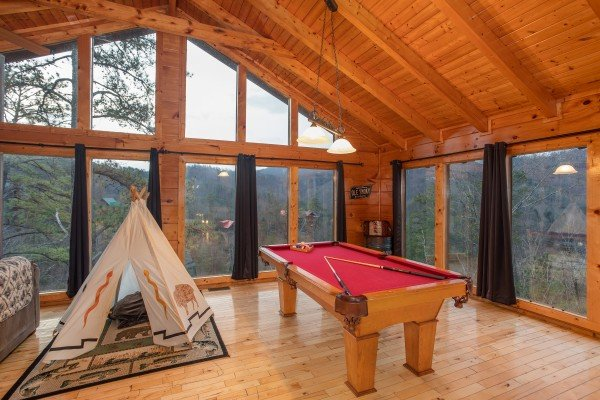 Pool table and tipi in the loft space at Black Bear Hide-out, a 3-bedroom cabin rental located in Pigeon Forge