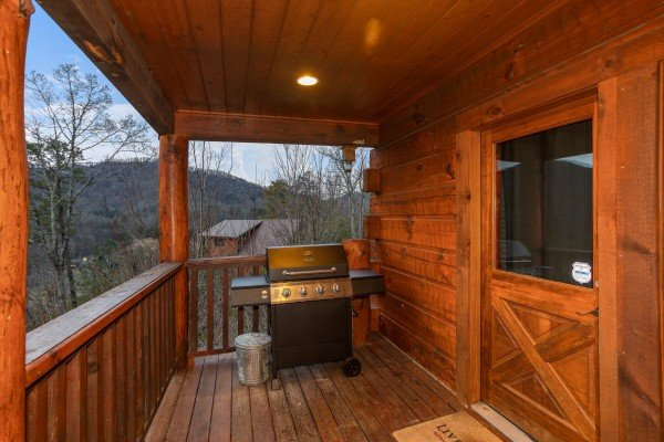 Gas grill on the covered deck at Black Bear Hide-out, a 3-bedroom cabin rental located in Pigeon Forge