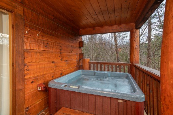 Hot tub on the covered deck at Black Bear Hide-out, a 3-bedroom cabin rental located in Pigeon Forge