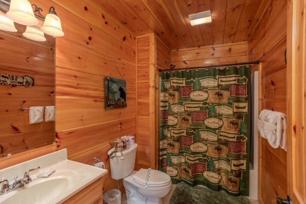 Bathroom with a tub and shower at Black Bear Hide-out, a 3-bedroom cabin rental located in Pigeon Forge