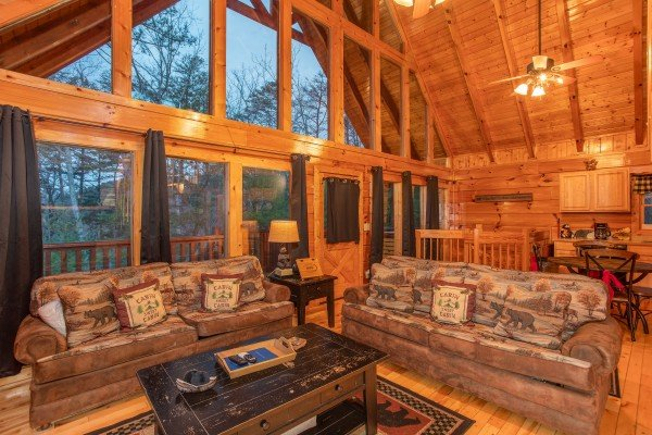 Vaulted ceiling with floor-to-ceiling windows at Black Bear Hide-out, a 3-bedroom cabin rental located in Pigeon Forge