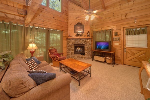 Living room with fireplace and television at A Place to Remember, a 2 bedroom cabin rental located in Gatlinburg