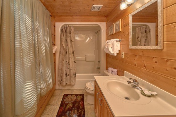 Bathroom with shower and tub at A Place to Remember, a 2 bedroom cabin rental located in Gatlinburg