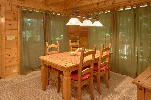 Dining room table with seating for four at A Place to Remember, a 2 bedroom cabin rental located in Gatlinburg