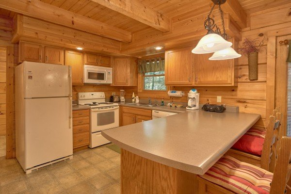Kitchen with appliances and counter seating at A Place to Remember, a 2 bedroom cabin rental located in Gatlinburg