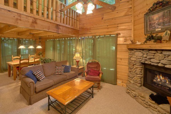 Living room and dining table for four at A Place to Remember, a 2 bedroom cabin rental located in Gatlinburg