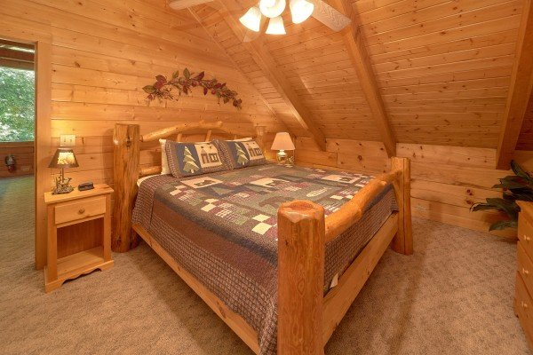 Log bed in a lofted room at A Place to Remember, a 2 bedroom cabin rental located in Gatlinburg