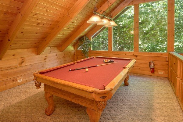 Pool table in a lofted space at A Place to Remember, a 2 bedroom cabin rental located in Gatlinburg